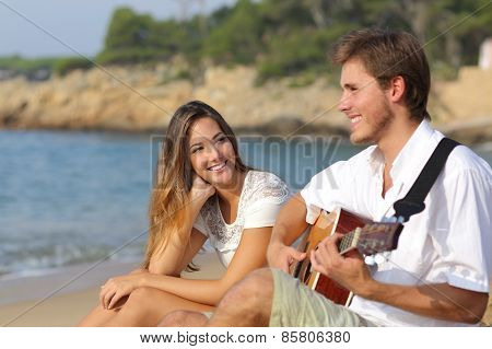 Man Flirting Playing Guitar While A Girl Looks Him Amazed