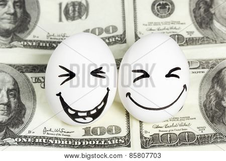 Eggs with faces on money