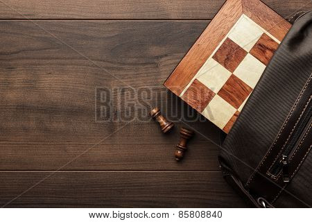 chess board with figures in the brown bag