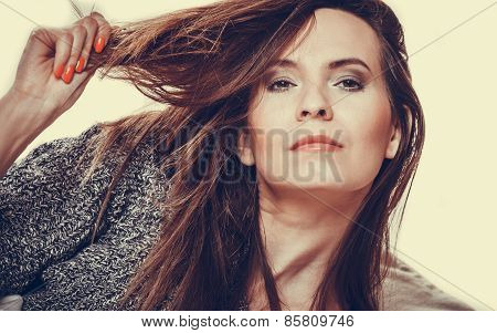 Woman Holding Hand Long Hair And Looking Unhappy.
