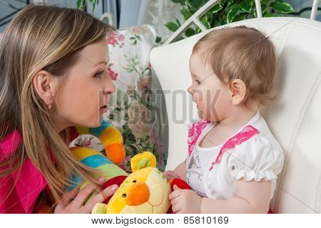 Happy Mother With  Baby Daughter