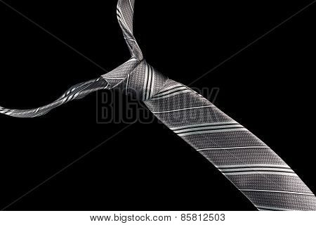 Necktie in silk with silver,black and gray stripes