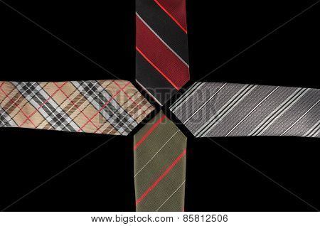 Four neckties with their ends facing each other