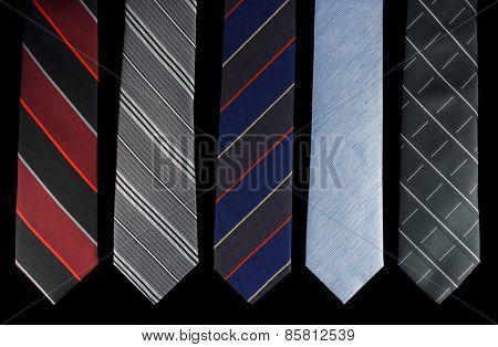 Five neckties is different colors