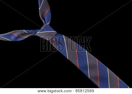 Necktie in wool with red, yellow and blue stripes