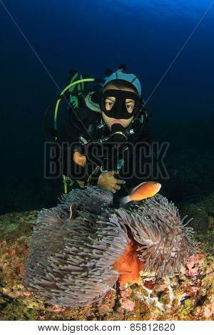 Woman Scuba diver and Nemo fish