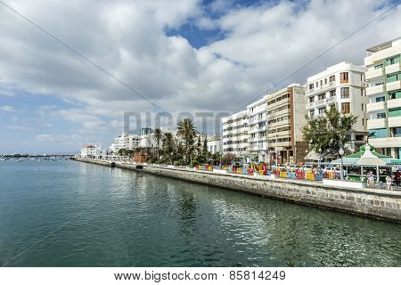 People Walk Along The Promenade In Arrecife