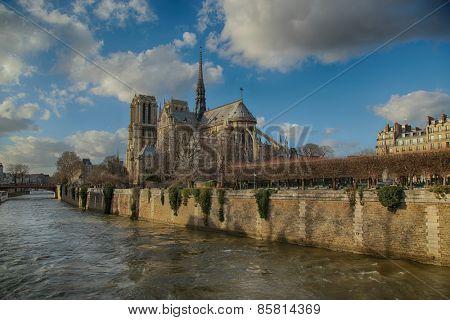 PARIS, FRANCE, MARCH 02 2015:  Back view of Notre Dame de Paris along the la Seine river in Paris, France.
