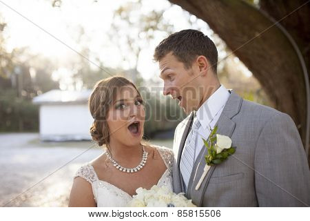Newly married couple together with surprised look