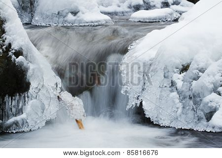 waterfall in winter in the Vosges mountains, France