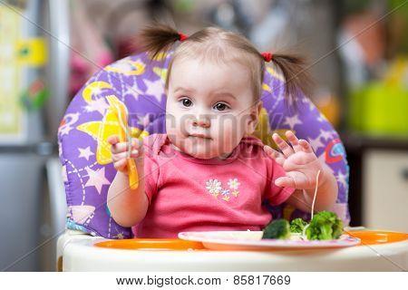 kid eating food on kitchen