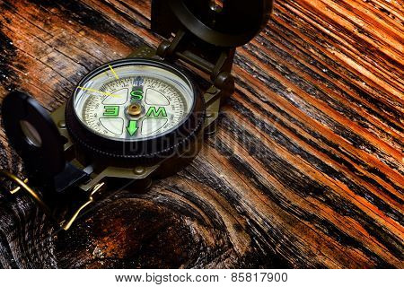 compass on wooden surface and steam