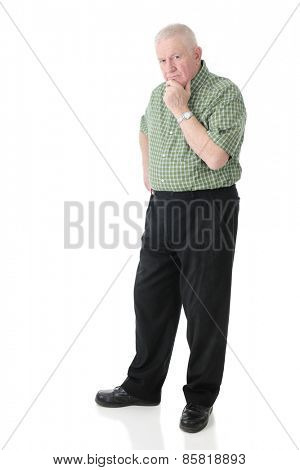 A standing senior adult man glaring at the viewer, obviously thinking.  On a white background.