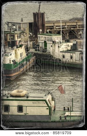 Vintage postcard of ships moored at a shipyard