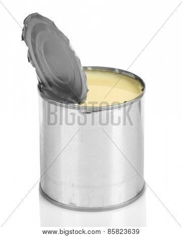 Tin can of condensed milk isolated on white