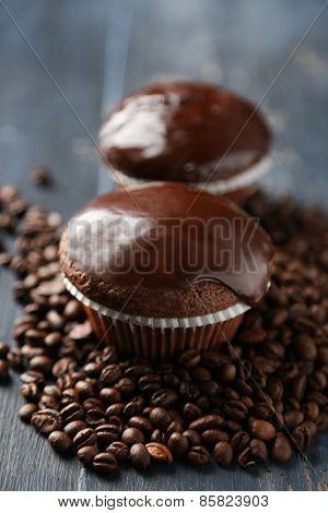 Composition with tasty homemade chocolate muffins and coffee beans