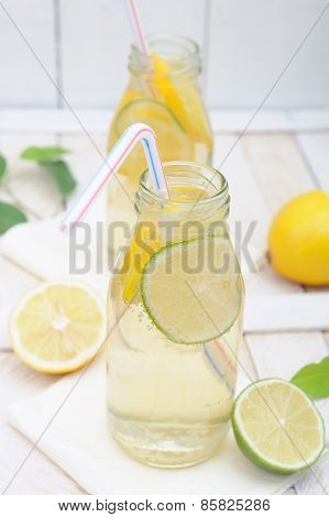 Lemonade In Jar With Slices Of Lime And Lemon