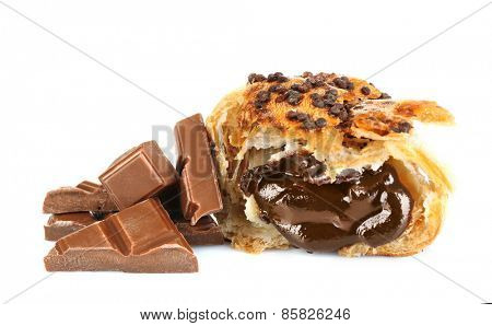Fresh and tasty croissant with chocolate chunks, isolated on white