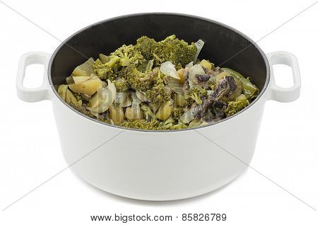 Cooking pot full of vegetables isolated on white background.