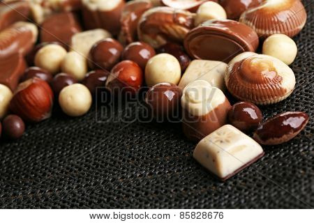 Different kinds of chocolates on dark background