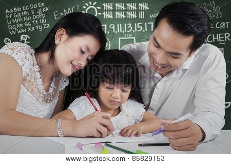 Happy Family Writing On Book
