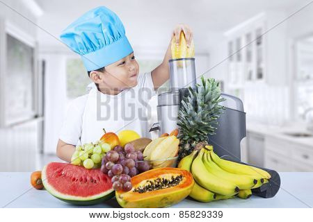 Little Boy Making Fruit Juice