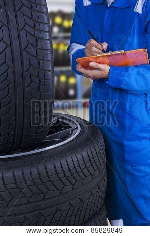 Mechanic Examine The Tires Condition