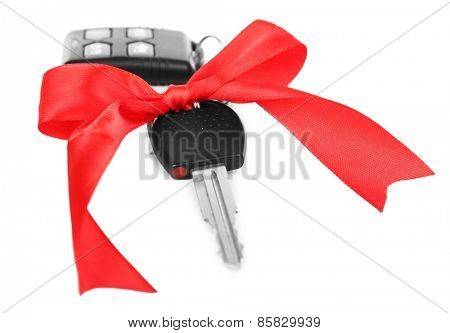 Car keys with red bow as present isolated on white