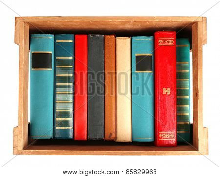 Books in wooden box, top view