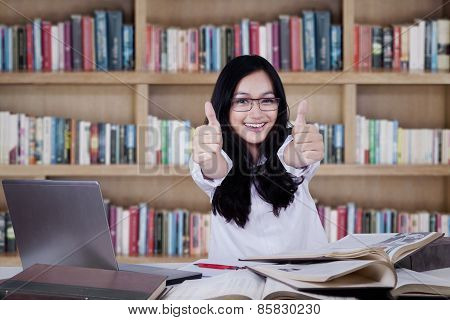 Modern Girl Showing Thumbs Up In Library