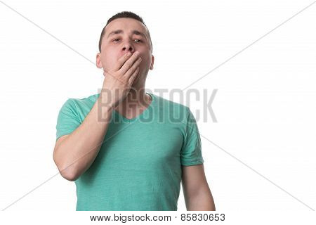Young Man Yawning - Isolated On White Background
