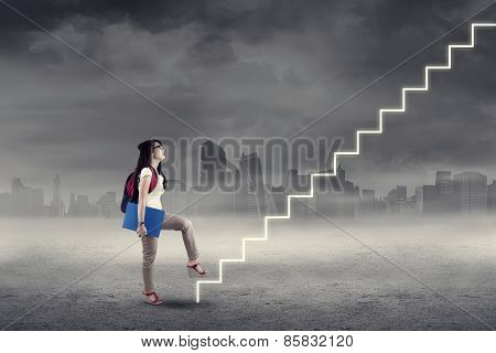 Student Stepping Up On Stairs