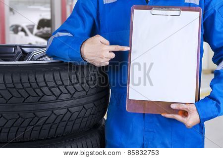 Technician Showing Empty Paper