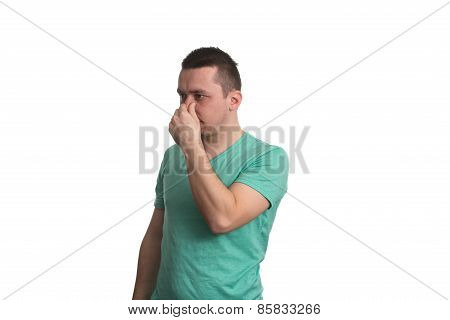 Man Touching His Nose And Has Unpleasant Pain