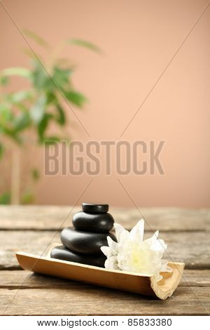 Beautiful spa composition on wooden table, on brown background