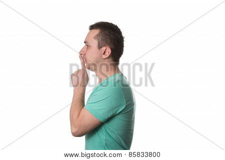 Man Showing Gesture Of Shh On White Background