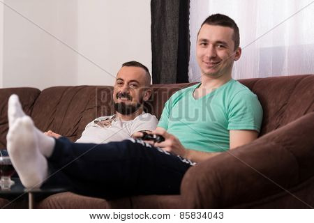 Men Having Fun With A New Videogame