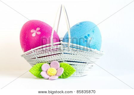 Crimson And Blue Easter Eggs In A Basket With Lilac Flower