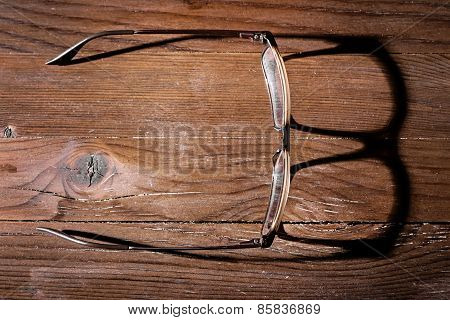 Old Glasses On Wooden Table