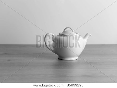 old ceramic teapot ,  black and white