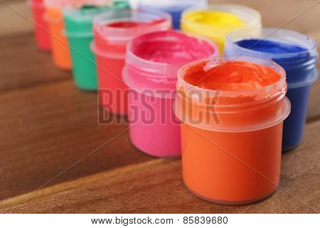 Colorful paint on wooden planks background