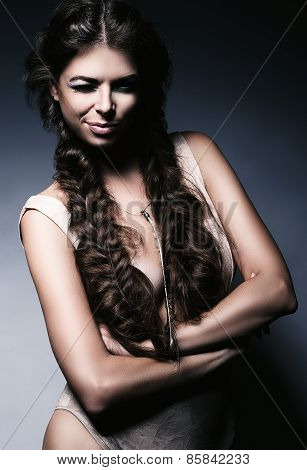Charming Winking Woman With Braids
