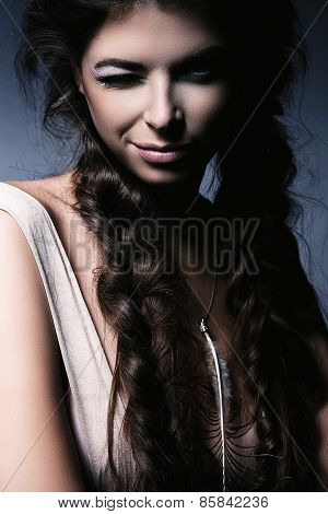 Charming Winking Woman With Fluffy Braids