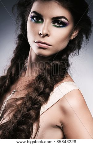 Serious Woman With Long Braids