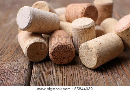 Wine corks on wooden background