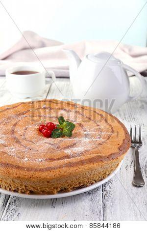 Tasty homemade pie on table