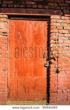 Red Metal Door And Brick Work