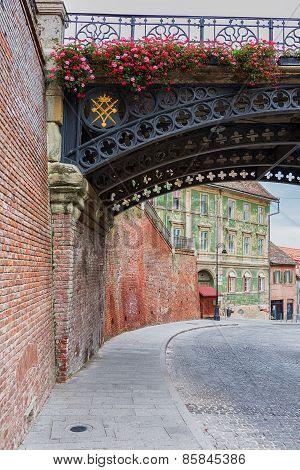 Old cobblestone street in Sibiu, Romania.