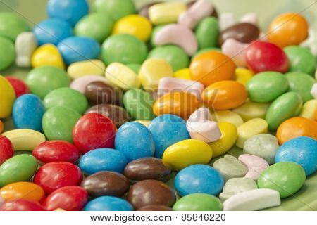 Colorful candy lying on saucer