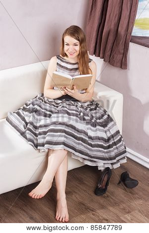 closeup portrait of beautiful young woman having fun holding book